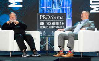 Co-founder of Apple, Steve Wozniak and Proforma CTO, Brian Carothers sitting on stage in white chairs.