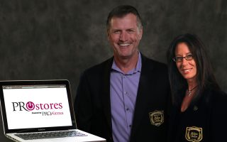 Proforma Affiliate Owners Rick Royall and Kristen Scotto standing next to a laptop with the ProStores Logo as the background.