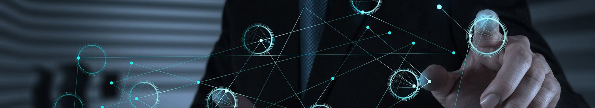 Man in business suit touching a node on a holographic interface that looks like a node on a network.